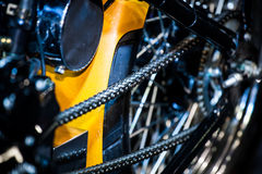 Closeup of detail a motorcycle rear chain. In show room Stock Photos