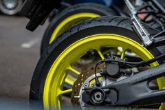 Closeup detail of motorcycle rear wheels and brake disc - Image royalty free stock photography