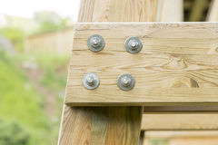 Closeup detail of new wooden beams fastened with bolts. Stock Images