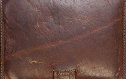 Closeup detail on old brown leather texture background. Closeup detail on old brown leather texture background royalty free stock photo