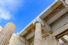 Closeup detail of part of the Athens Parthenon being reconstructed showing rebuilt pillars and new fabricated pieces being fit tog stock photos