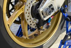 Closeup detail of a race motorcycle rear wheel and brake disc royalty free stock photography
