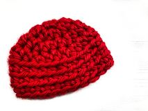 Red Crocheted Baby Cap in Bulky Yarn Royalty Free Stock Image