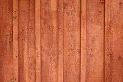Closeup Detail of Red Cedar Siding Exterior Finish. Closeup detail of red cedar wood siding exterior finish on a residential house. The home is given a rustic royalty free stock photo
