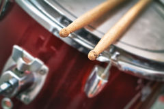 Closeup detail of red drums. With focus on drumsticks stock photo