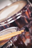 Closeup detail of red drums. With focus on drumsticks. Copy space Stock Photography