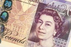 Twenty Pound Note. Closeup detail of  United Kingdom twenty pound note with image of Queen Elizabeth and the Bank of England stock image