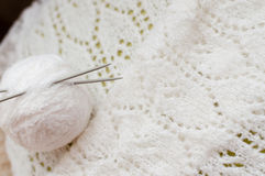Closeup detail of woven handicraft knit white sweater Stock Photos
