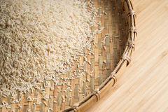 Closeup details of Brown rice  in bamboo back grounds. Selective focus Royalty Free Stock Images