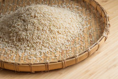Closeup details of Brown rice  in bamboo back grounds. Selective focus Stock Images
