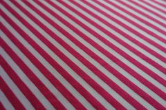 Closeup of diagonally striped fabric in pink and white. Close shot of diagonally striped fabric in pink and white Stock Photography