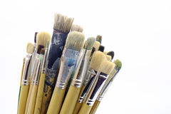 Closeup different paintbrushes on white background photo Royalty Free Stock Image