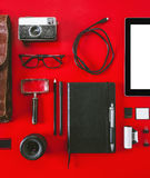 Closeup of different photography objects on red background. Royalty Free Stock Photo