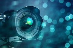 Closeup of a digital camera and shiny bokeh background. Closeup of a digital camera and shiny bokeh background Royalty Free Stock Photography