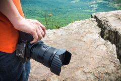 Closeup digital camera in woman`s hand at view point. Travel lif Royalty Free Stock Photos