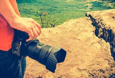 Closeup digital camera in woman`s hand at view point. Travel lif Stock Photo