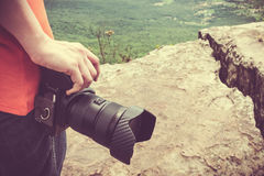 Closeup digital camera in woman`s hand at view point. Travel lif Royalty Free Stock Photo