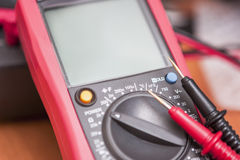 Closeup of Digital Multimeter Unit with Two Probes Connected Royalty Free Stock Photography