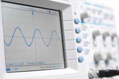 Closeup on a digital oscilloscope showing a sinuso. Idal waveform in nice high key light stock photos