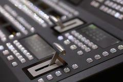 Closeup of digital video switcher control panel. Closeup view of digital video switcher control panel. Selective focus royalty free stock photos