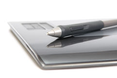 Closeup of digitizer with pen. On white background Royalty Free Stock Image