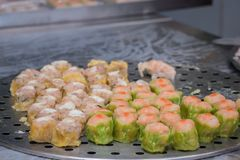 Closeup Dim Sum ,Chinese food steamed dumpling on stainless steel tray background. Dim Sum ,Chinese food steamed dumpling on stainless steel tray background royalty free stock photos