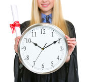 Closeup on diploma and clock in hand of woman Royalty Free Stock Images