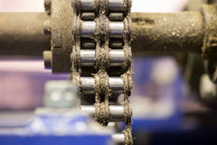 Closeup dirty ratchet gear with chain drive Stock Photos