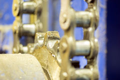 Closeup dirty ratchet gear with chain drive Stock Image
