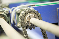 Closeup dirty ratchet gear with chain drive Royalty Free Stock Image