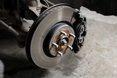 Closeup disc brake of the vehicle for repair. Closeup disc brake of the vehicle for repair royalty free stock images