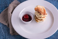 Closeup dish with pancakes and strawberry Royalty Free Stock Photos