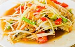 Closeup a dish of papaya spicy salad Stock Photos