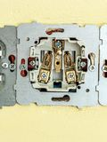 Closeup of dissasembled wall socket Royalty Free Stock Photo