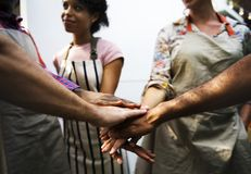 Closeup of diverse hands joined together as teamwork royalty free stock photo