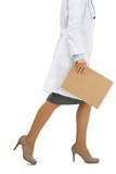 Closeup on doctor with clipboard going sideways Stock Photo