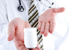 Closeup, doctor holding little pills bottle Stock Photography