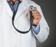 Closeup Doctor Holding Stethoscope Stock Photo