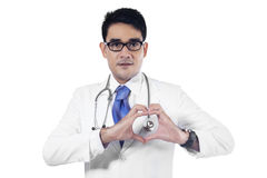 Closeup of doctor making heart shape Stock Photos