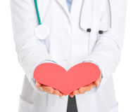 Closeup on doctor outstretching paper heart Royalty Free Stock Image