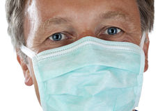 Closeup of doctor's face protected with mask Royalty Free Stock Photo