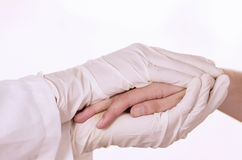 Closeup of doctor's hands comforting patient. Isolated on white Royalty Free Stock Image