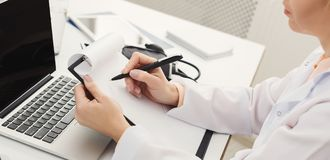 Closeup of doctor taking notes stock images