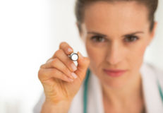 Closeup on doctor woman examining using flashlight Royalty Free Stock Photo