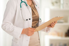 Closeup on doctor woman holding clipboard Royalty Free Stock Images