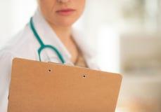 Closeup on doctor woman holding clipboard Stock Photos
