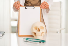 Closeup on doctor woman showing blank clipboard Stock Images