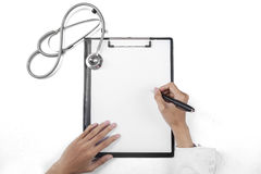 Closeup of doctor writing on blank paper Royalty Free Stock Photos