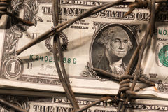 Closeup of Dollar Banknote with Barbed Wire