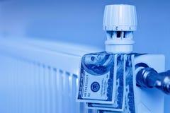 Closeup dollar bills inside a radiator. Cool blue color Stock Image